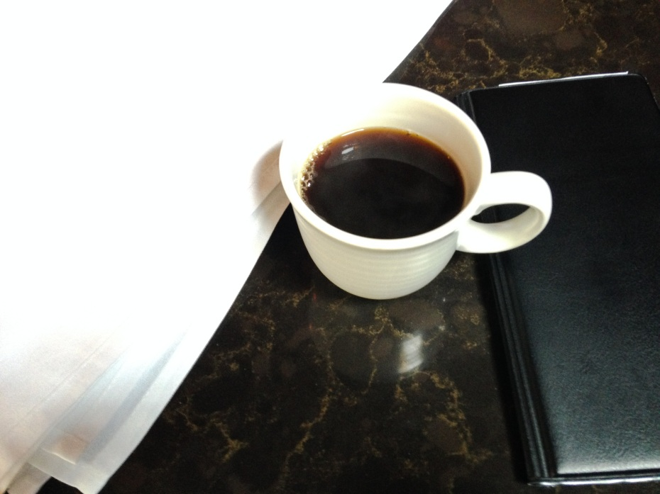 Nothing like a nice cup of coffee to go with afternoon napkin folding